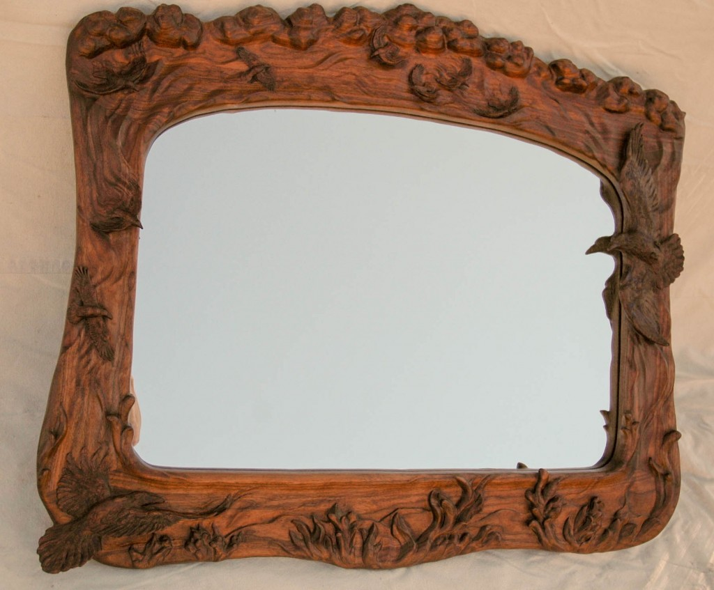 Hand carved walnut raven mirror