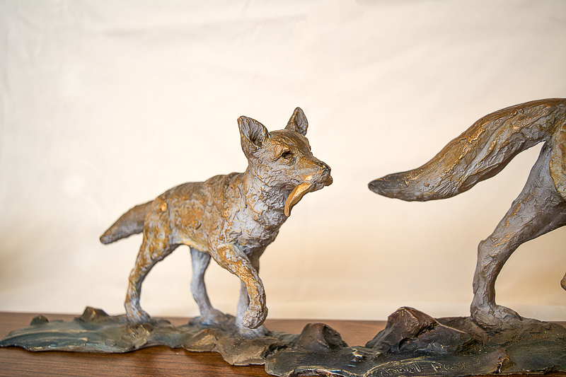 coyote pup and mom sculpture