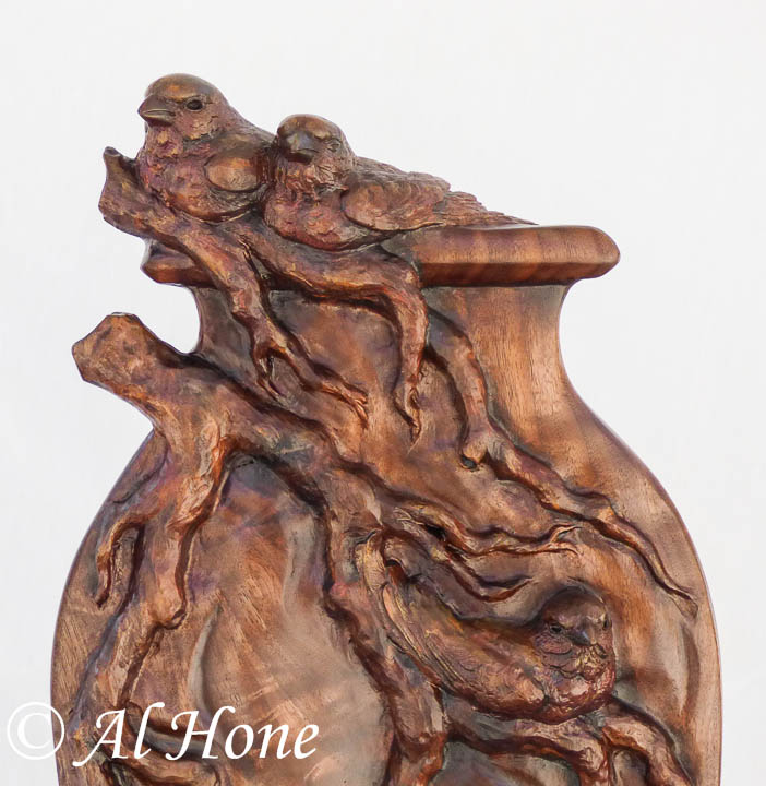 Wood sculpture of finches