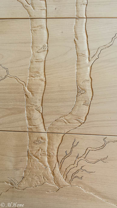 Carved aspen trees on dresser