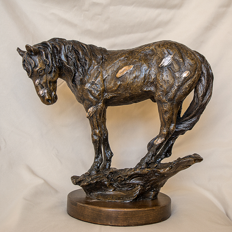 wild horse in the rain sculpture