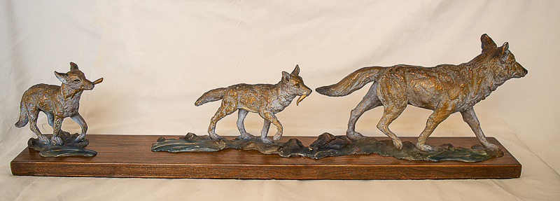 Coyote mom and pups sculpture