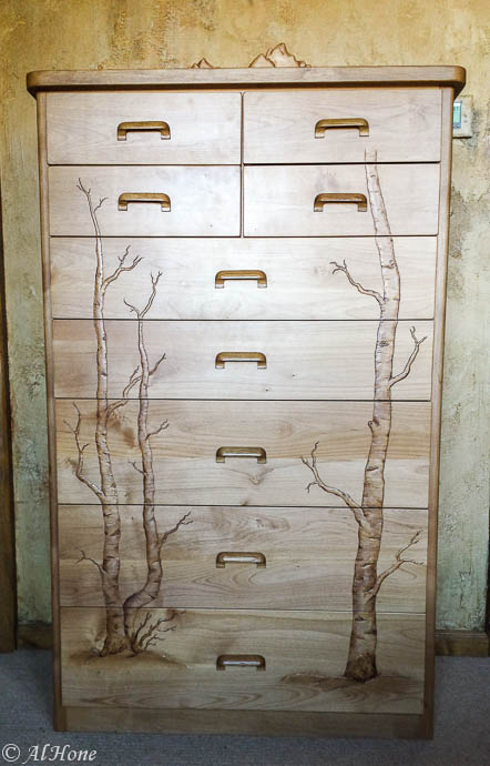 It's been busy around here, carved dresser